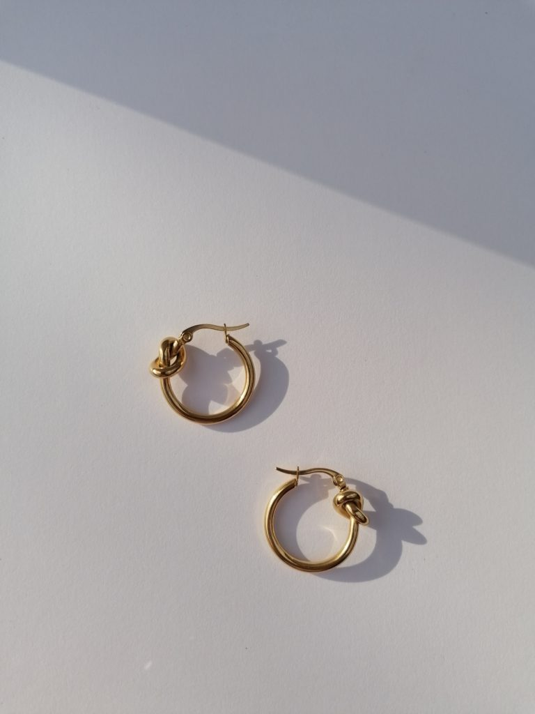 Gold plated hoop earrings with knot detail